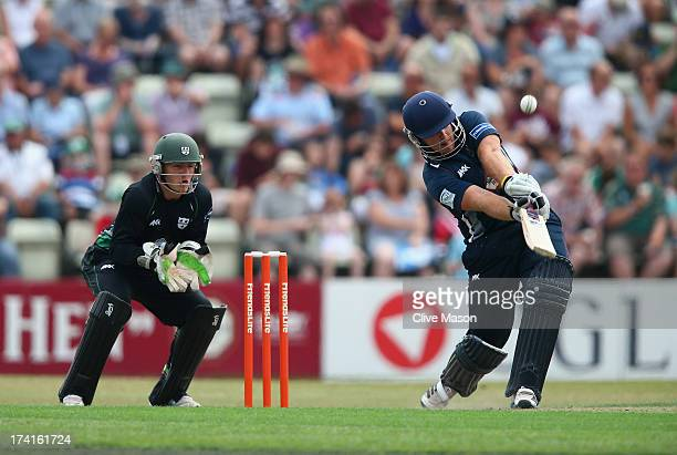 Richard Levi of Northants hits out on his way to a half century as Ben Cox of Worcestershire looks on during the Friends Life T20 match between...