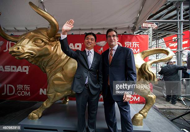 Richard Liu Qiangdong JDcom founder and chairman left and Robert Bob Greifeld chief executive officer of Nasdaq OMX Group Inc stands for a photograph...