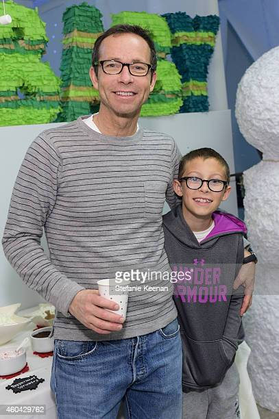Richard Lovett and James Lovett attend Baby2Baby Holiday Party Presented By The Honest Company on December 13 2014 in Los Angeles California
