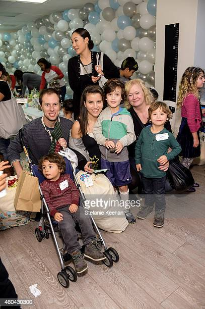 Richard Lovett James Lovett and guests attend Baby2Baby Holiday Party Presented By The Honest Company on December 13 2014 in Los Angeles California