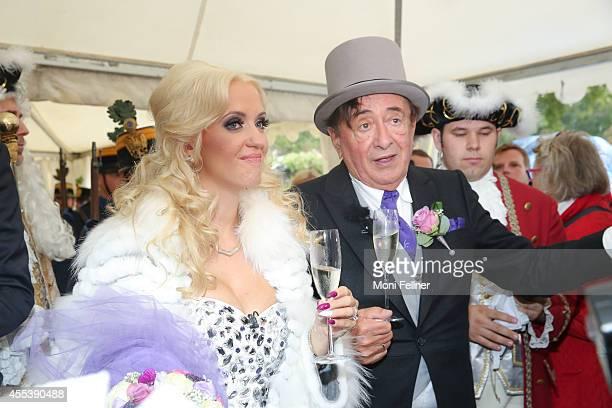 Richard Lugner and Cathy Schmitz celebrate their wedding at Liechtenstein Palace on September 13 2014 in Vienna Austria