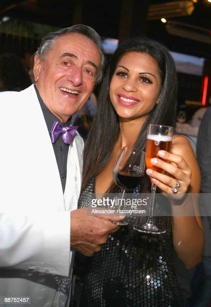 Richard Lugner attends with Nina the Movie Meets Media party at discoteque P1 on June 29, 2009 in Munich, Germany.