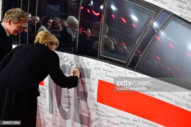 Richard Lutz chairman of German railway operator Deutsche Bahn looks on as German Chancellor Angela Merkel signs an ICE high speed train after the...