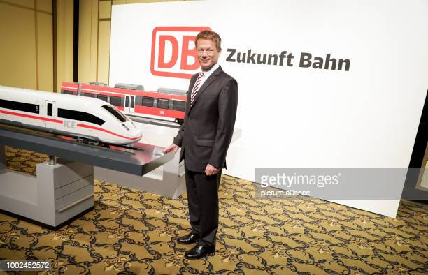 Richard Lutz Chairman of the Board of Deutsche Bahn poses for the camera next to a model train ahead of the start of the semiannual Deutsche Bahn...