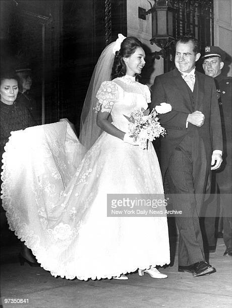 Richard M. Nixon escorts his daughter Julie from their Fifth Avenue apartment to Marble Collegiate Church where she will wed David Eisenhower.