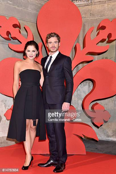 Richard Madden and Annabel Scholey walk a red carpet for 'I Medici' on October 14 2016 in Florence Italy