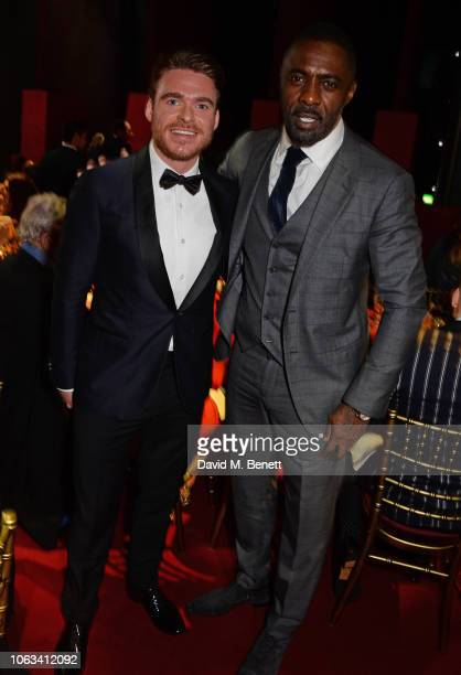 Richard Madden and Idris Elba attend The 64th Evening Standard Theatre Awards at the Theatre Royal, Drury Lane, on November 18, 2018 in London,...
