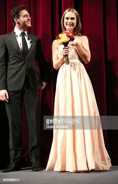 Richard Madden and Lily James attend the 'Cinderella' premiere during the 65th Berlinale International Film Festival at Berlinale Palace on February...