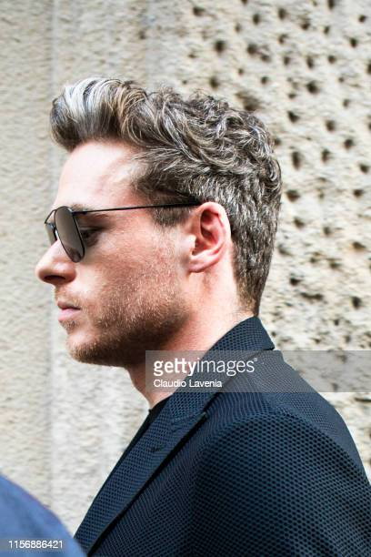 Richard Madden is seen outside Giorgio Armani show, during the Milan Men's Fashion Week Spring/Summer 2020 on June 17, 2019 in Milan, Italy.
