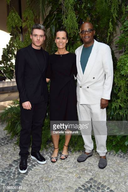 Richard Madden Roberta Armani and Samuel L Jackson attend the Giorgio Armani fashion show during the Milan Men's Fashion Week Spring/Summer 2020 on...