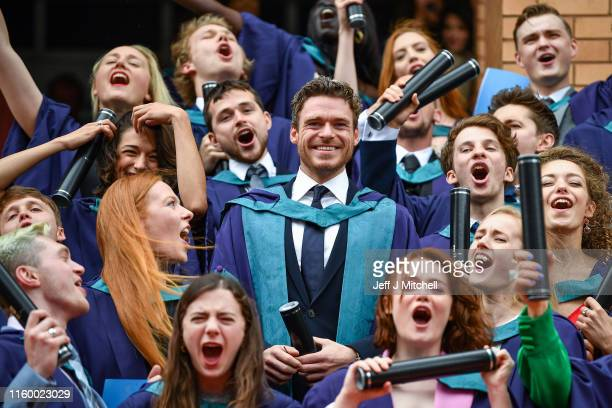 Richard Madden stands on the steps of the Royal Conservatoire of Scotland following receiving an honorary doctorate for his contribution to drama on...