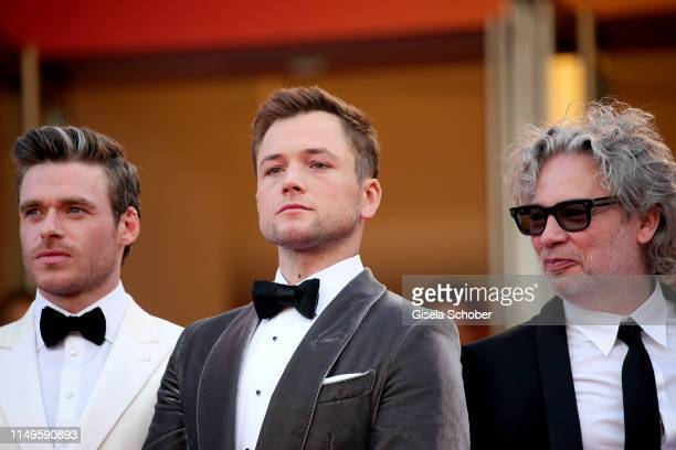 Richard Madden Taron Egerton and Director Dexter Fletcher attend the screening of Rocketman during the 72nd annual Cannes Film Festival on May 16...