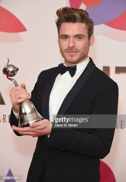 Richard Madden winner of the Best Drama Performance award for 'Bodyguard' poses in the Winners Room during the National Television Awards held at The...
