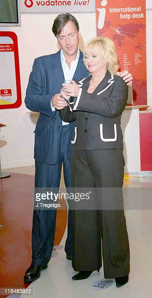 Richard Madeley and Judy Finnigan during Richard and Judy Launch New Vodafone Service Photocall at Vodafone Experience Store in London Great Britain
