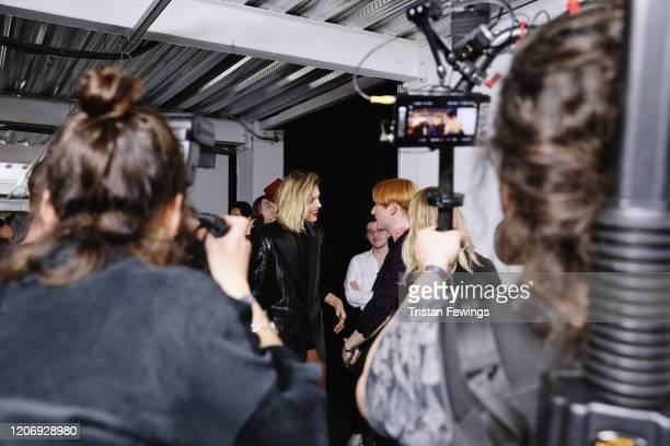 Richard Malone winner of the International Woolmark Prize 2020 with Anja Rubik backstage during London Fashion Week February 2020 at Ambika P3 on...