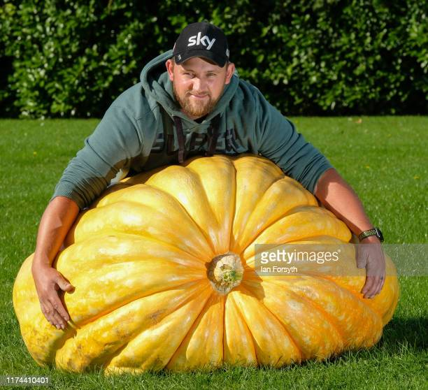 Richard Mann from Leeds poses with his winning pumpkin of 291.7 kilos during a press photo call at the Harrogate Autumn Flower Show on September 13,...