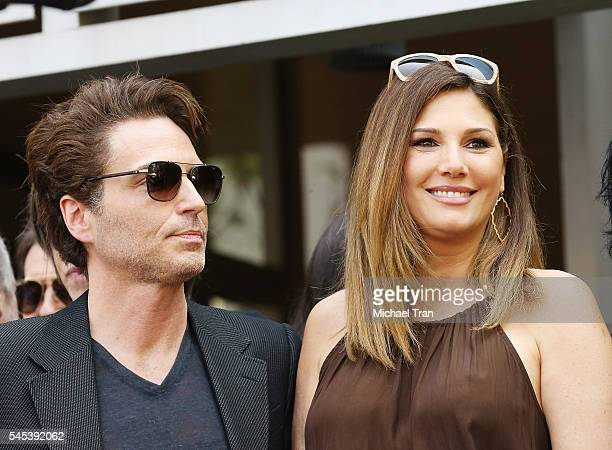 Richard Marx and Daisy Fuentes attend onstage during the Ringo Starr Birthday Celebration held in front of the Capitol Records building on July 7...