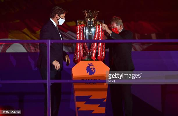Richard Masters Chief Executive of Premier League and Sir Kenny Dalglish Former Captain and Manager of Liverpool place The Premier League trophy upon...