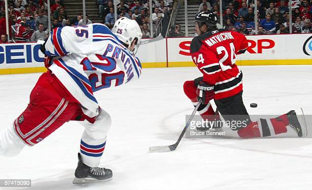 Richard Matvichuk of the New Jersey Devils goes to one knee trying to block a shot by Petr Prucha of the New York Rangers during NHL playoff action...