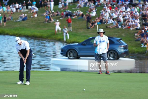 Richard McEvoy of England holes the winning putt on the 18th green during the final round of the Porsche European Open at Green Eagle Golf Course on...