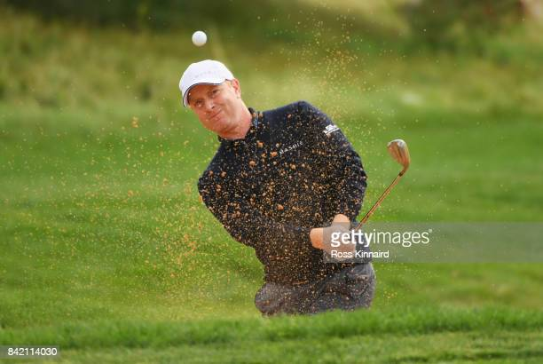 Richard McEvoy of England plays his second shot from a bunker on the 7th hole during the final round on day four of the DD REAL Czech Masters at...