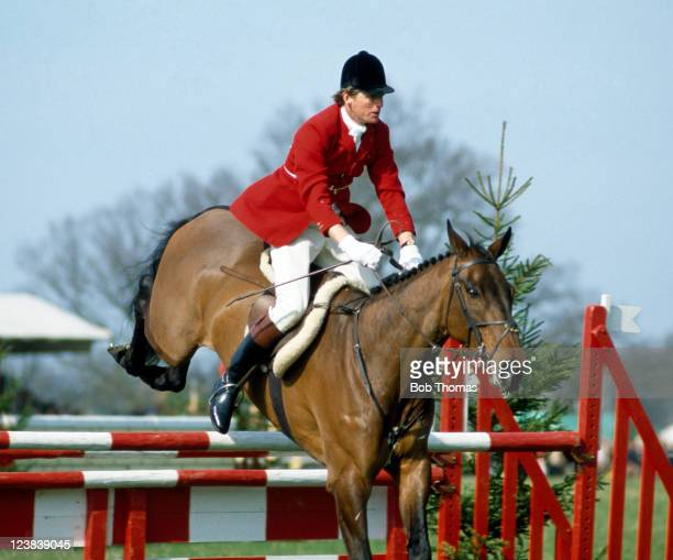 Richard Meade of Great Britain riding his horse Speculator III during the showjumping element of the Badminton Horse Trials, circa May 1982.