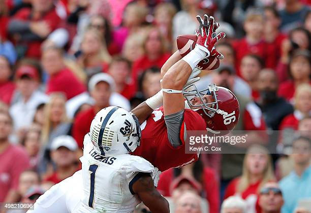 Richard Mullaney of the Alabama Crimson Tide pulls in this touchdown reception against Raymere Thomas of the Charleston Southern Buccaneers at...