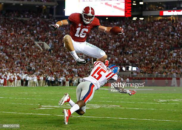 Richard Mullaney Richard Mullaney of the Alabama Crimson Tide leaps over Kendarius Webster of the Mississippi Rebels on the way to a touchdown at...