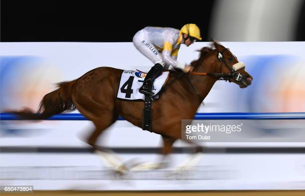 Richard Mullen riding Raven's Corner wins the Borealis - an IPIC Group Company race during the Meydan Races at the Meydan Racecourse on March 9, 2017...