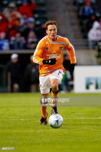 Richard Mulrooney of the Houston Dynamo dribbles against the Kansas City Wizards during the game at Community America Ballpark on April 12 2008 in...