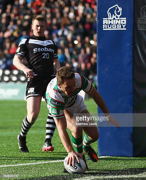 Richard Myler of the Warrington Wolves scores a try during the Super League match between Widnes Vikings and Warrington Wolves at the Stobart Stadium...