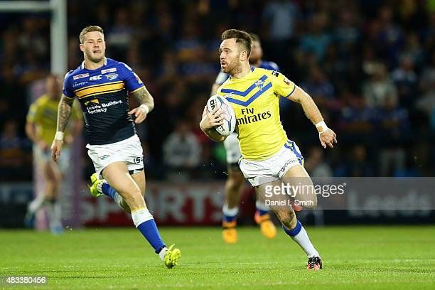 Richard Myler of Warrington Wolves searches for an opening during the Round 1 match of the First Utility Super League Super 8s between Leeds Rhinos...