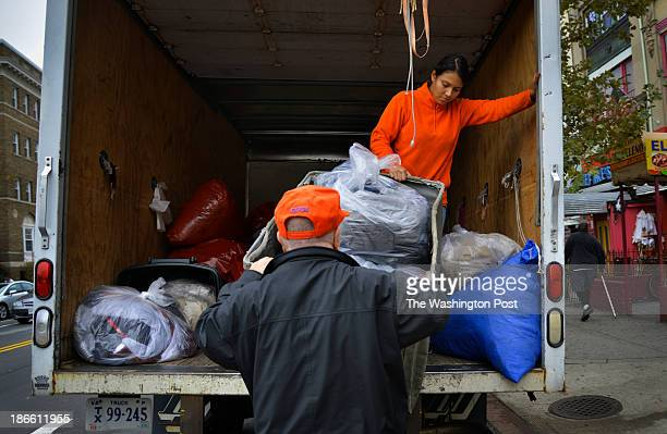 Richard Nashwinter, front, and Yesli Guebara, both of The Clothing Recycle Company, deliver discarded clothes to Christ House, a homeless shelter in...