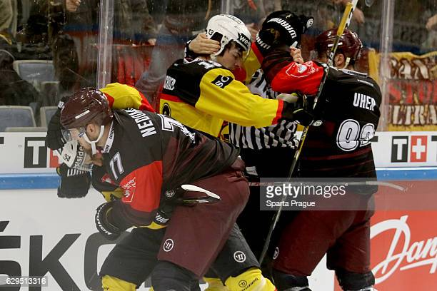 Richard Nedomlel and Dominik Uher of HC Sparta Prague challenges Eric Blum and Luca Hischier of Bern during the Champions Hockey League Quarter Final...