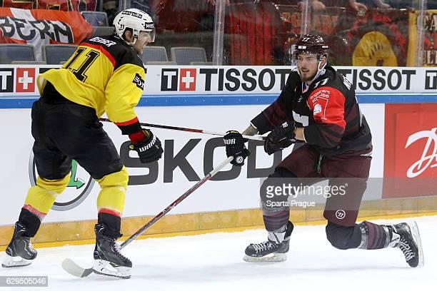Richard Nedomlel of HC Sparta Prague challenges Alain Berger of Bern during the Champions Hockey League Quarter Final match between Sparta Prague and...