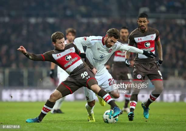 Richard Neudecker of St Pauli and Enrico Valentini of Nuernberg and Jeremy Dudziak of St Pauli battle for the ball during the Second Bundesliga match...