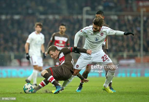 Richard Neudecker of St Pauli and Enrico Valentini of Nuernberg battle for the ball during the Second Bundesliga match between FC St Pauli and 1 FC...