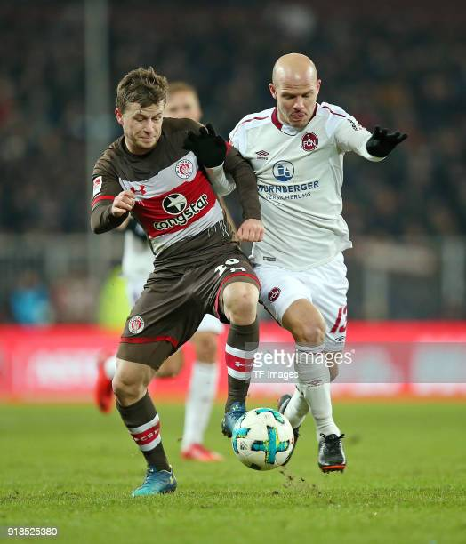 Richard Neudecker of St Pauli and Tobias Werner of Nuernberg battle for the ball during the Second Bundesliga match between FC St Pauli and 1 FC...