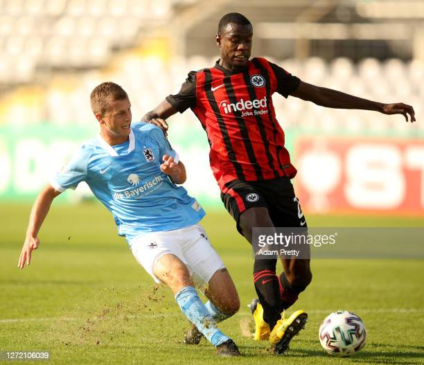 Richard Neudecker of TSV 1860 Muenchen is challenged by Evan Ndicka of Eintracht Frankfurt during the DFB Cup first round match between TSV 1860...