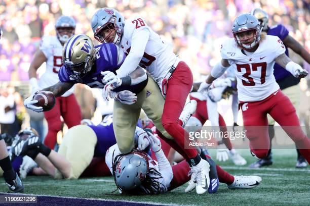 Richard Newton of the Washington Huskies scores a two yard touchdown against Bryce Beekman of the Washington State Cougars in the third quarter...