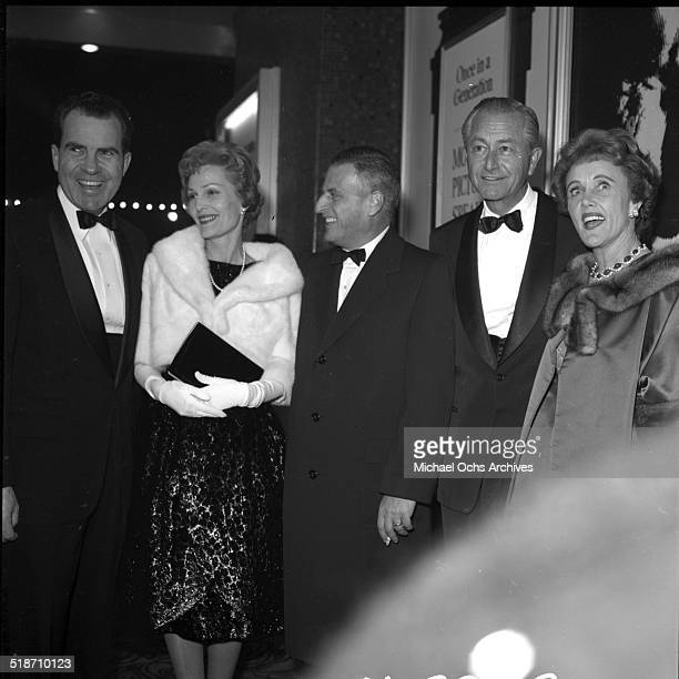 Richard Nixon and wife Pat attend an event with actor Robert Young and his wife Elizabeth Louise Henderson in Los AngelesCA