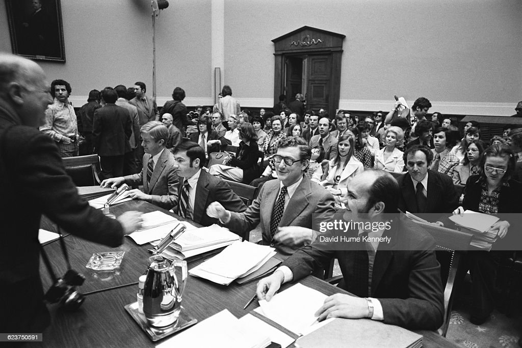 Richard Nixon impeachment Judiciary Committee hearing on Capitol hill on April 25, 1974. Attorney Hillary Rodham (before she married Bill Clinton), is seated on the far right, and next to her is Bernie Nussbaum, who also worked on the same committee and would later serve as White House Chief Counsel under President Bill Clinton. Seated at the table are attorneys for the committee, including John Doar, second from right, and William Weld, far left. Standing on the left is New York Times photographer George Tames. .