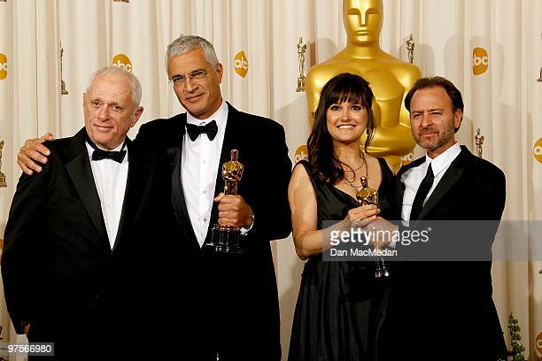 Richard O'Barry director Louie Psihoyos producer Paula DuPre Presman and actor Fisher Stevens with their Oscars for Best Documentary Feature for The...