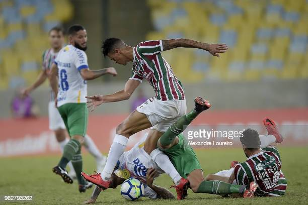 Richard of Fluminense struggles for the ball with Leandro Pereira of Chapecoense during the match between Fluminense and Chapecoense as part of...
