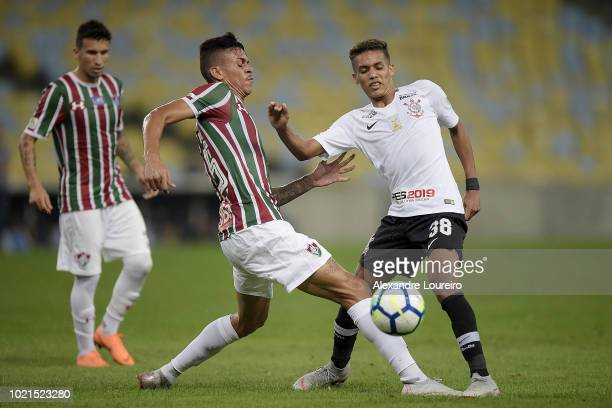Richard of Fluminense struggles for the ball with Pedrinho of Corinthians during the match between Fluminense and Corinthians as part of Brasileirao...