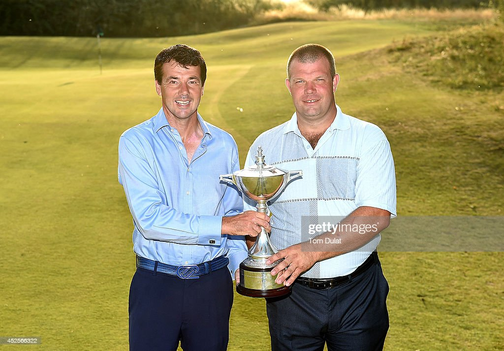 Richard O'Hanlon (L) and Andrew Jones (R) pose for photographs after winning the Lombard Trophy West Regional Qualifier at Burnham and Berrow Golf Club on July 23, 2014 in Burnham-on-Sea, England.