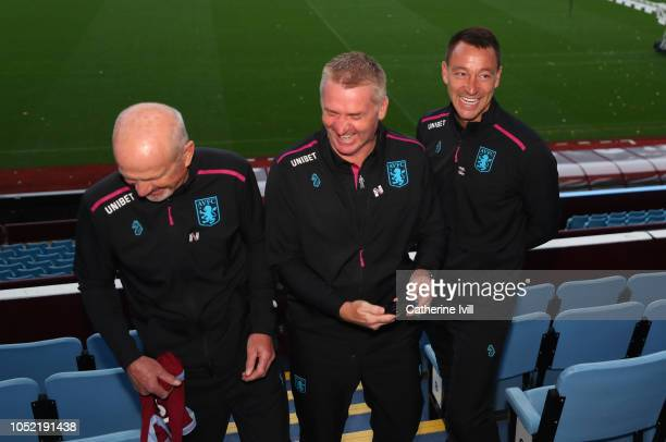 Richard O'Kelly Assistant head coach Dean Smith manager and John Terry assistant manager of Aston Villa share a joke during a press conference at...