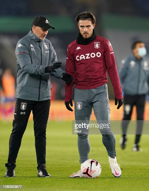 Richard O'Kelly Assistant Head Coach of Aston Villa speaks to Jack Grealish of Aston Villa prior to the Premier League match between Leicester City...