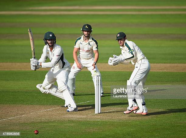 Richard Oliver of Worcestershire cuts the ball to the boundary in front of Chris Read and James Taylor of Nottinghamshire during the LV County...