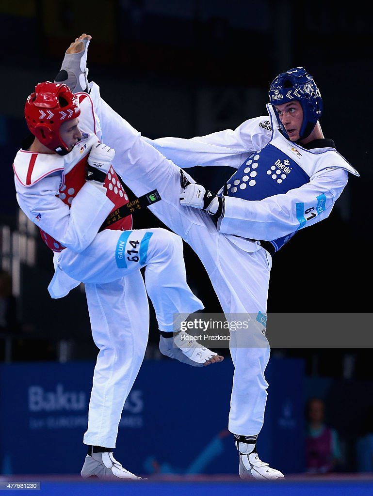 Richard Ordemann of Norway (Blue) and Albert Gaun of Russia compete in the Taekwondo Preliminary Round Men 80Kg during day six of the Baku 2015 European Games at the Crystal Hall on June 18, 2015 in Baku, Azerbaijan.